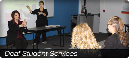 two sign language interpreters teaching in front of a class