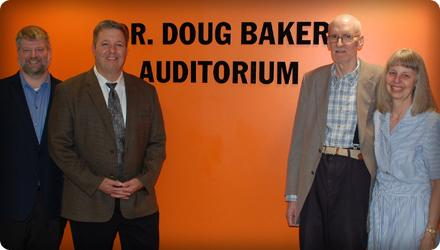 Liberal Arts Division Head Jason Stone, Academic Affairs Vice President Joey Fronheiser, Dr. Doug Baker and his wife, Linda, stand at the entrance of the newly renamed Dr. Doug Baker Auditorium.