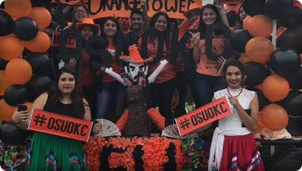 View of happy, festive people in OSU-OKC Hispanic Student Association (HSA) Parade