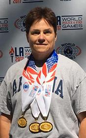 """Wojcik with her three World Police and Fire Games gold medals. """"Winning gold is a humbling and exciting achievement,"""" she says. """"I worked so hard preparing for the competition, but there is always the unknown when the competition starts. To come away with three gold medals is hard to describe."""""""